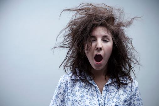 Young woman yawning, close up