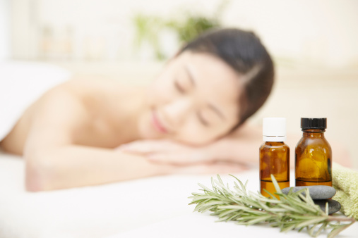 Aromatherapy oils with woman in background